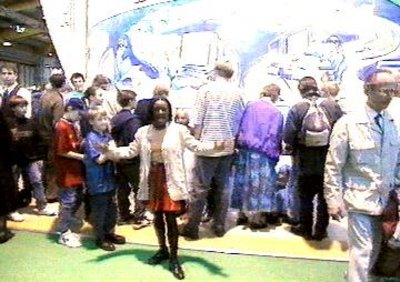 Blue Peter presenter Diane-Louise Jordan with a crowd of people behind her