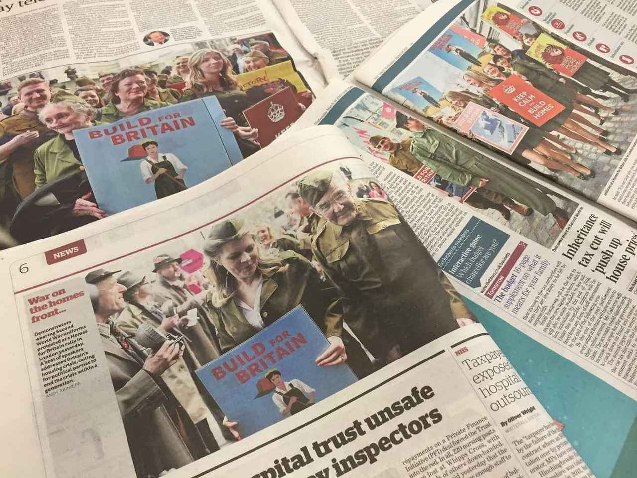 Newspapers open to stories featuring photographs of us in costume