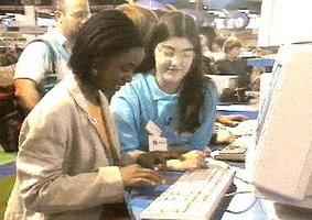 Presenter Diane-Louise Jordan at the stand being shown how to use the computer